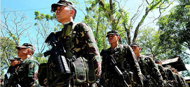 Retrained and armed with new Remington R4 rifles, soldiers from the Army's 30th Infantry Battalion stand in line before their deployment in Placer, Surigao del Norte on Tuesday. The soldiers are to help the Commission on Elections maintain orderly and peaceful elections there. (PHOTO BY FROILAN GALLARDO)