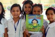 """Elementary students in all smiles while displaying Monsanto Philippines children book """"Lina's Town Rises Again"""" which won a Silve Anvil during the 51st Anvil Awards in Shangri-La Hotel, Makati."""