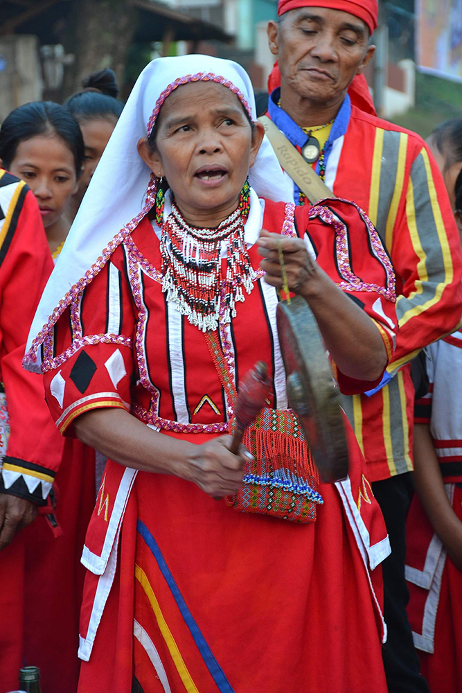 """A Higaonon """"bae"""" bangs the gong to signal the official opening of Kaamulan Festival in Malaybalay City, Bukidnon, over the weekend. The Kaamulan is held to celebrate the culture and tradition of the seven ethnic tribal groups—Bukidnon, Higaonon, Talaandig, Manobo, Matigsalug, Tigwahanon and Umayamnon—the """"original"""" inhabitants of the province. (PHOTO BY JILLIAN BACARISAS)"""